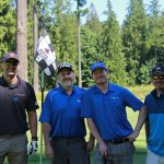 A team golfing at the Centra Cares golf tournament.