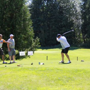 Another team golfing at the Centra Care tournament.