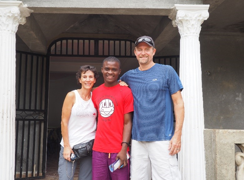Ed & Lisa Vandermeer with a young Haitian man.